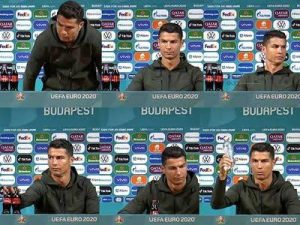 Cristiano Ronaldo removes bottles of Coca Cola from his press conference table